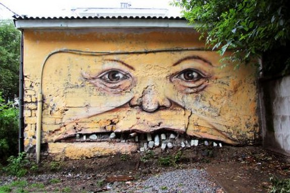 russian street artist raises 07 in Super Cool Building Graffiti Revive Old Buildings