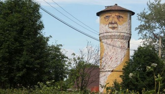 russian street artist raises 08 in Super Cool Building Graffiti Revive Old Buildings